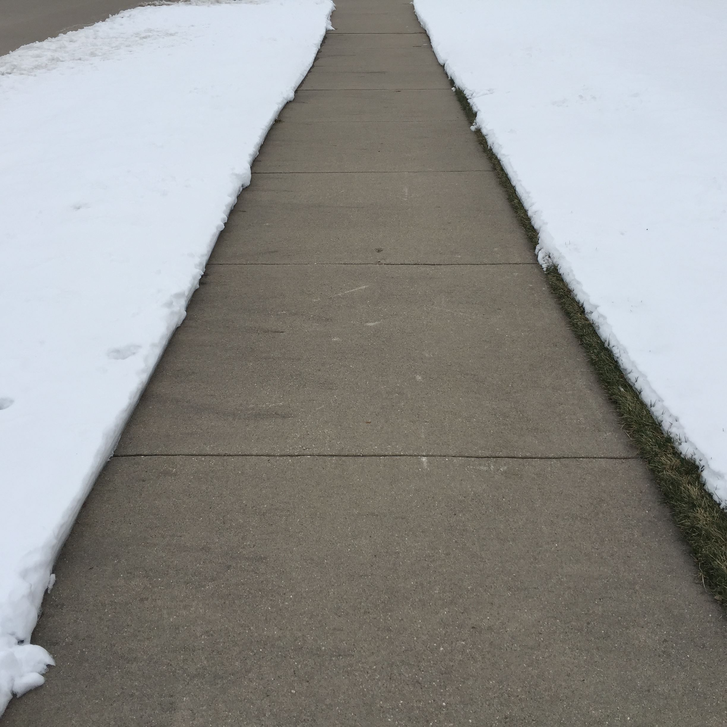 Responsibility of property owners to clear snow from sidewalks